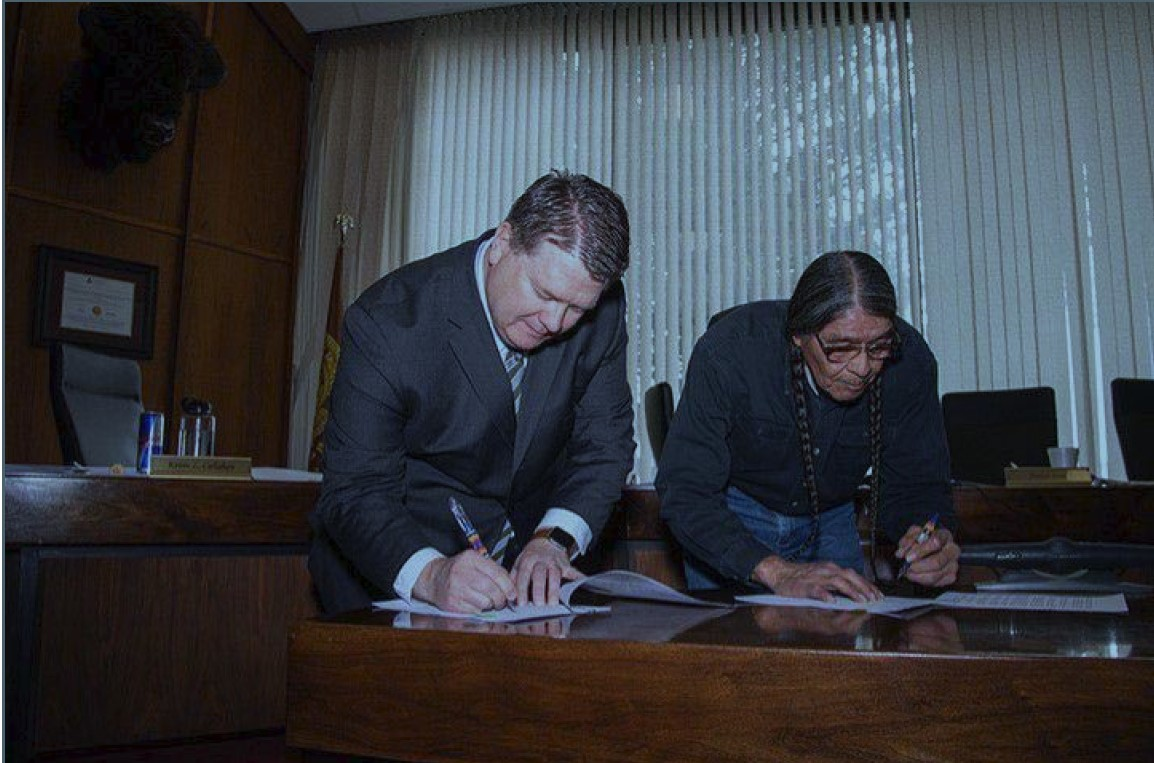 Snapshot of Satterlee and Chairman Small signing MOA