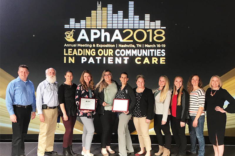 Students and faculty from the ISU College of Pharmacy pose on stage with their 1st, 2nd, and 3rd place awards at the annual APhA-ASP meeting and expo in Nashville, TN in March 2018