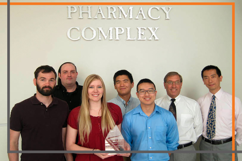 A team of ISU-Meridian researchers poses outside the Skaggs Pharmacy Complex in Meridian. Danny Xu (right), and Vaughn Culbertson (second from right) lead the team