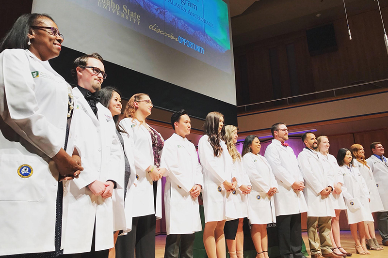 New pharmacy students from Anchorage, Alaska (P1s) receive their white coats in a traditional ceremony