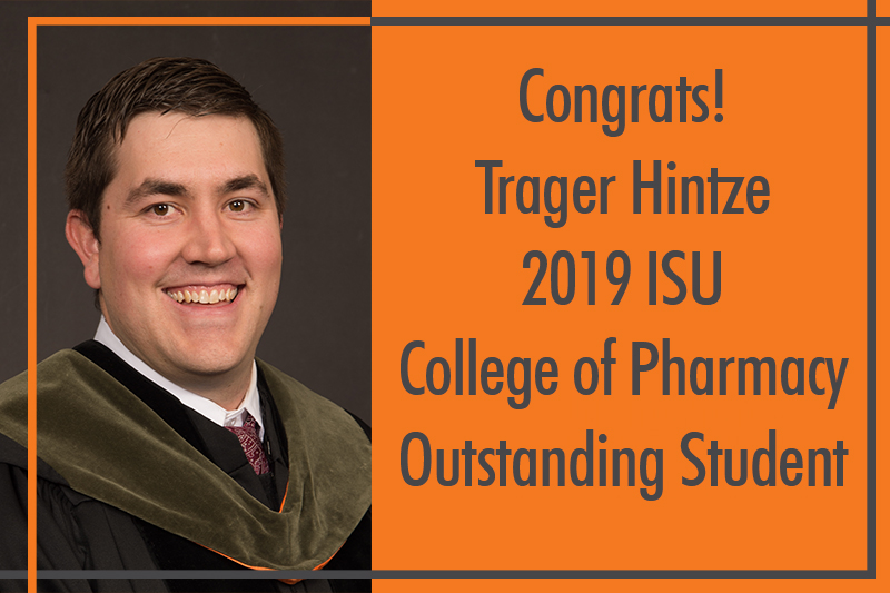 Trager hintze in black graduation robe and green pharmacy hood