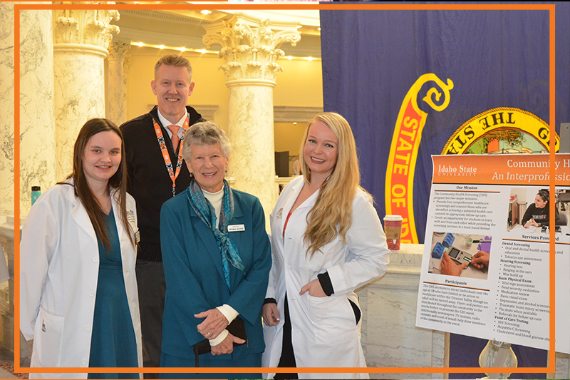 Interim Dean Chris Owens with Idaho Senator Regina Bayer and student pharmacists in white coats at the annual pharmacy day at the capitol