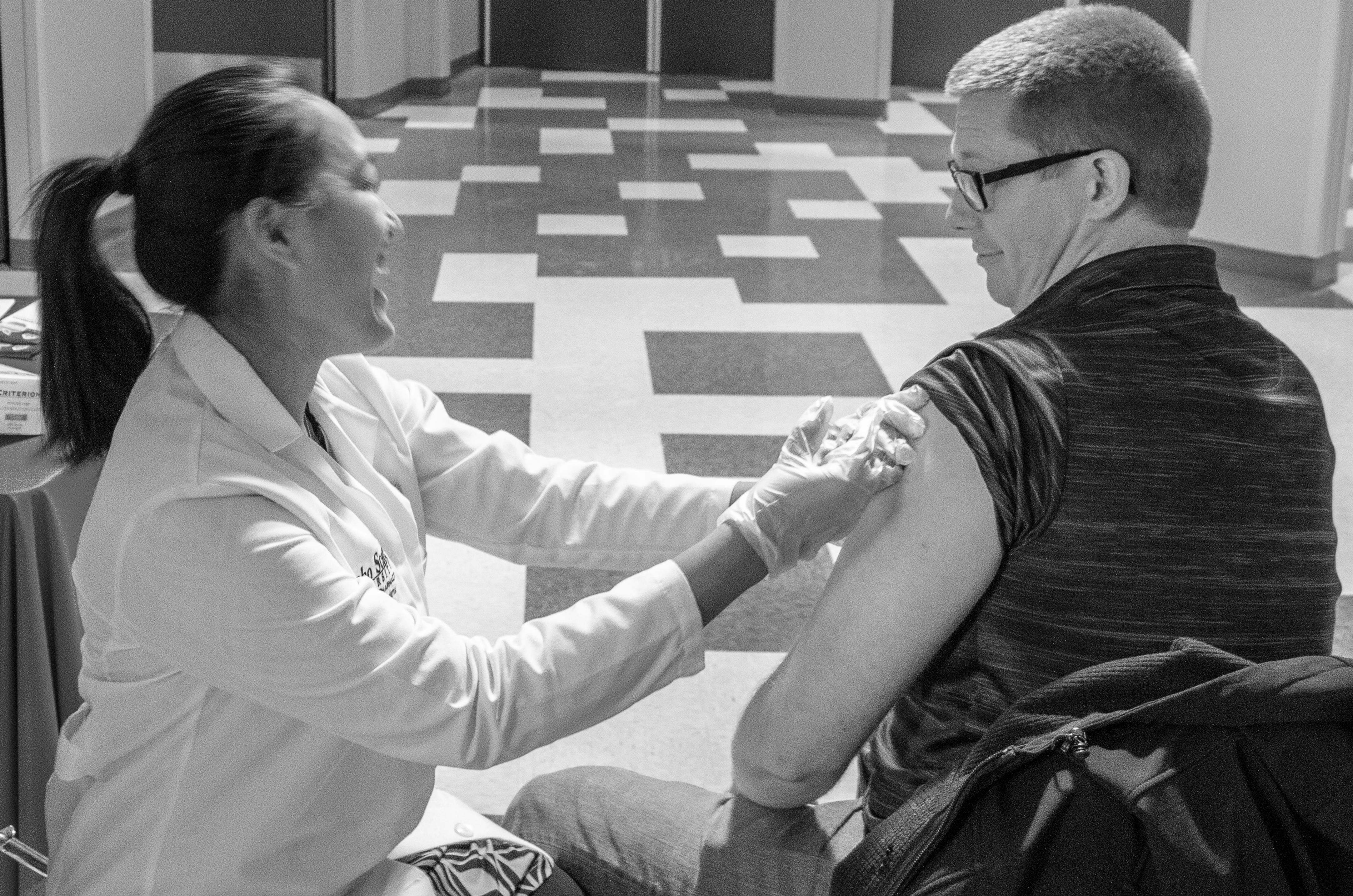 Student pharmacist administers flu shot to another student at ISU-Meridian