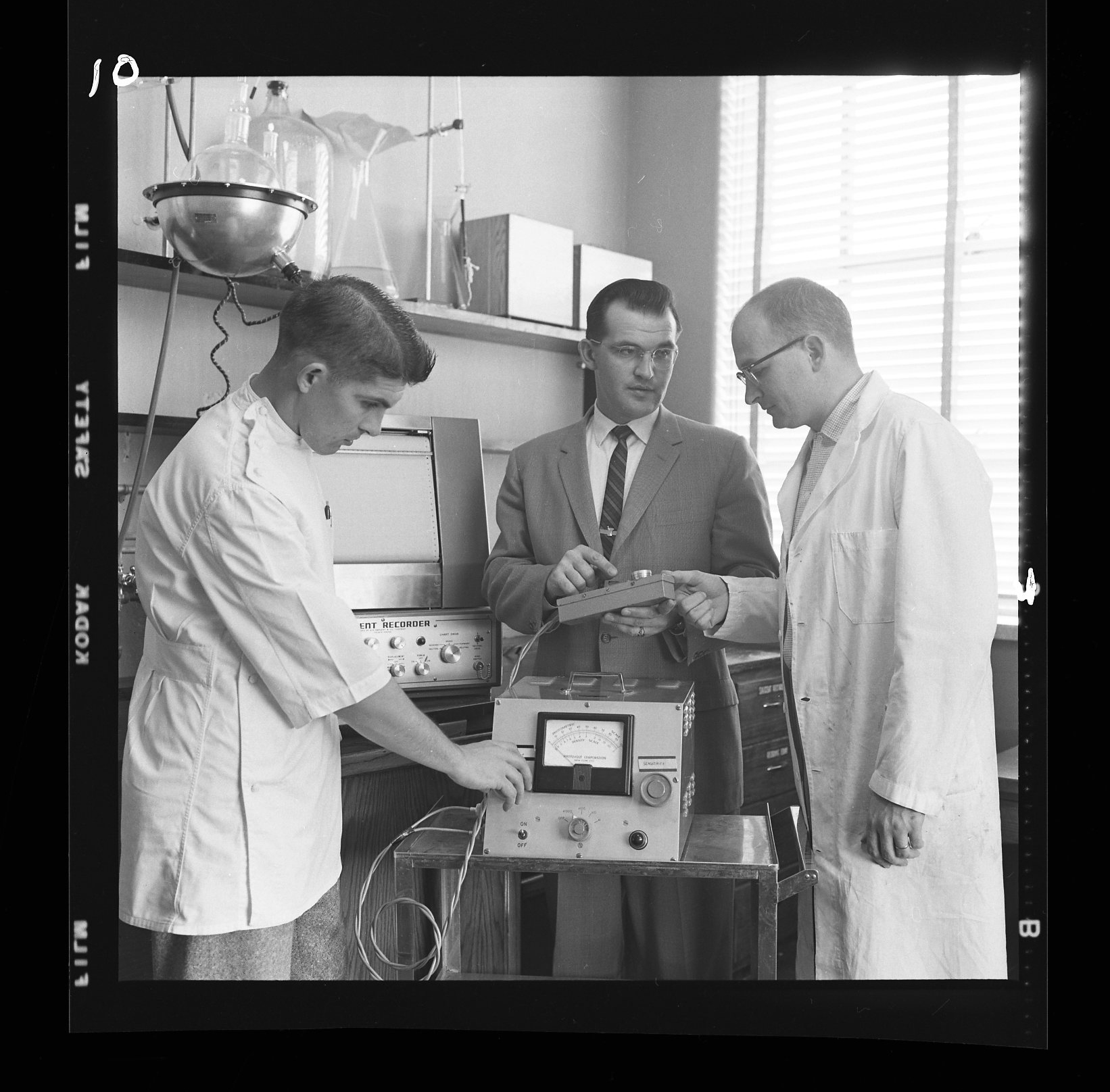 Historical photo of pharmacy dean and students in lab
