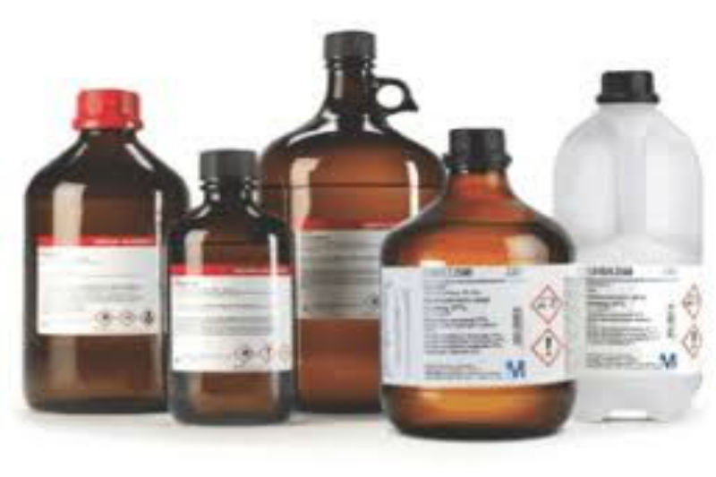 Five glass chemical bottles