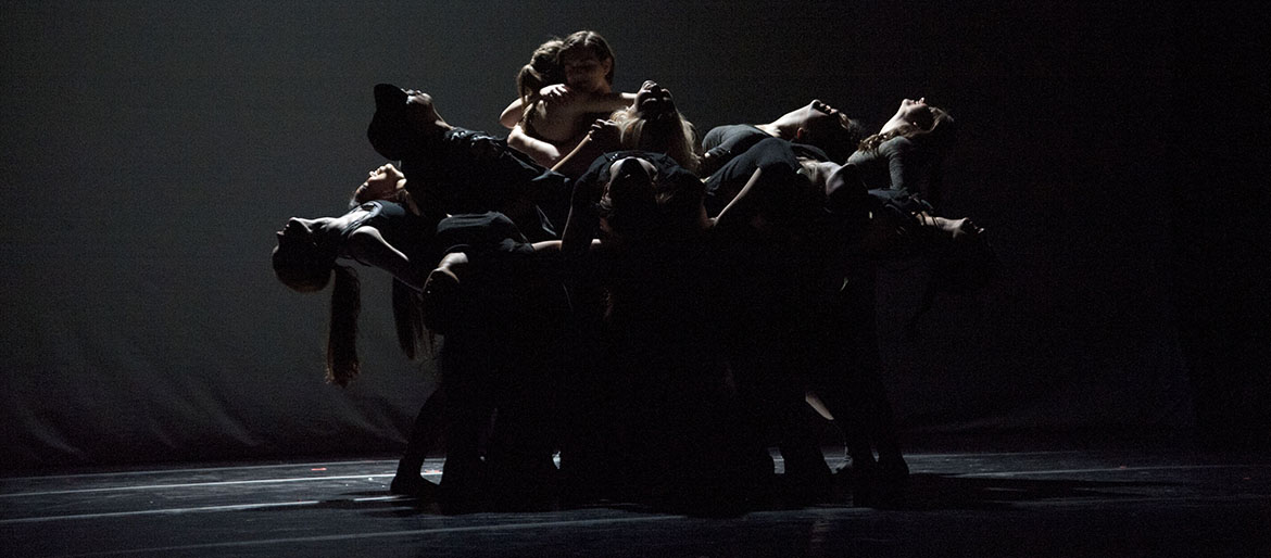 a group of dancers in a circle