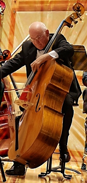 man playing the string bass