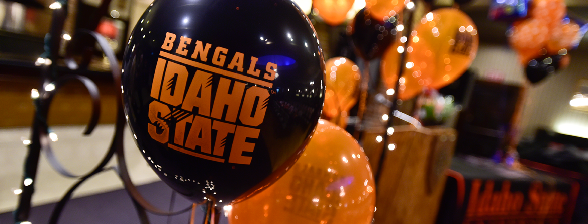 Graduation balloons with Black/Orange balloons with Bengals Idaho State lettering
