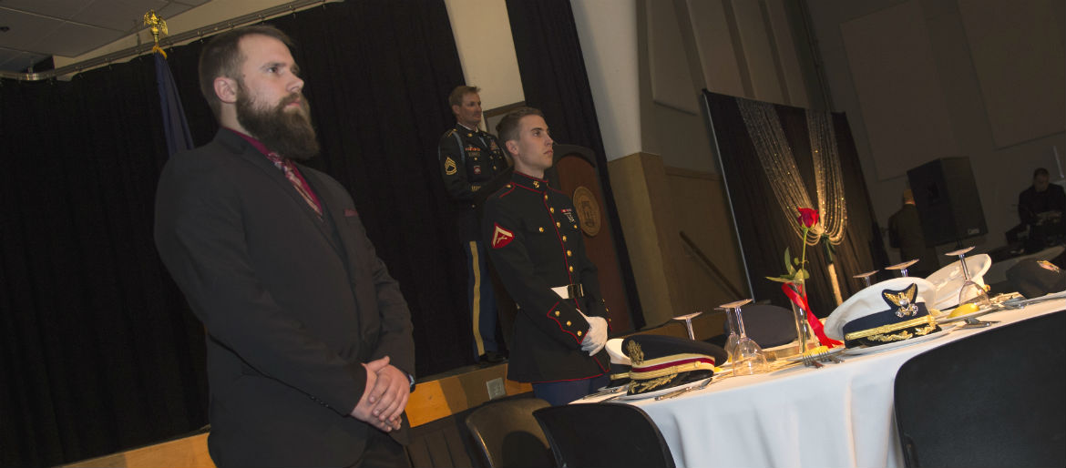 Two ISU student veterans and an ROTC Cadre member present the ceremony table for those Missing In Action/ Prisoner of War.