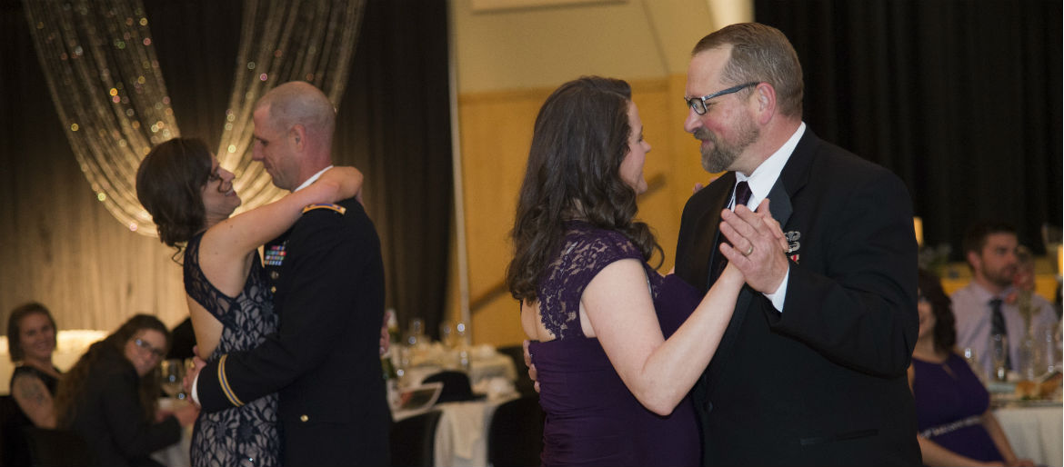 The guest speaker and the VSSC Director Todd Johnson dance with their dates for the first dance at the 2017 Military Ball