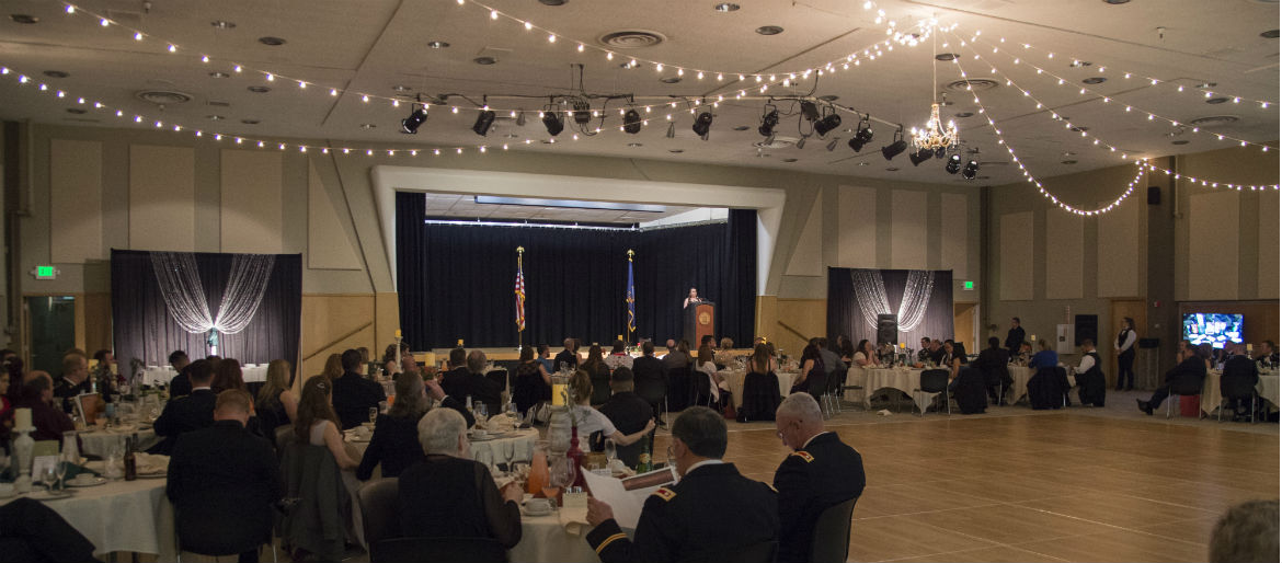 Wide shot of the 2017 Military Ball, guests dining with a view of the dance floor