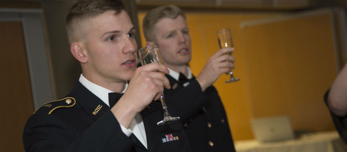Two ROTC Cadets participate in the evening's toasts.