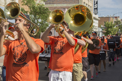 A picture of some of the Marching Band's horn section at the 2016 parade.