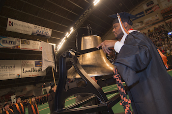 Craig Joseph ringing bell at commencement