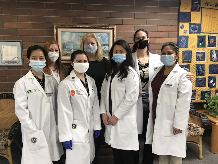 Group photo of Anchorage students who are administering COVID vaccines
