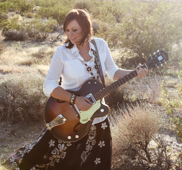 Bogguss playing the guitar.