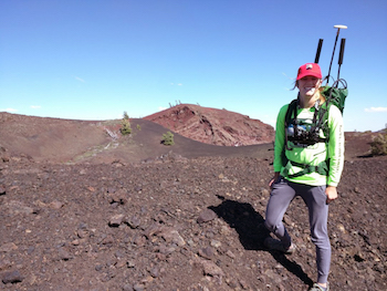 A photo of Erin Sandmeyer in the field at Craters of the Moon.