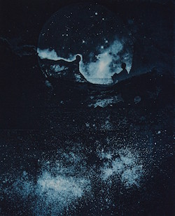 Photo of a painting the looks like outer space.