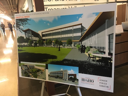 A photo of a poster of a rendering of the new ICOM Building.