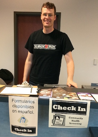 Photo of James Hunt at health fair table