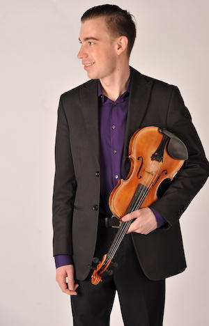 Jedd Greenhalgh posing with his violin.