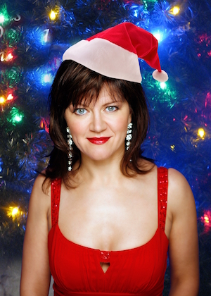 Photo of Michelle Bertling Brett with Santa hat on.