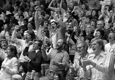 Spectators cheer during the 1977 game.