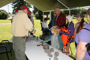 Photo of kids and parents talking to scientist at NASA Arco Community day.