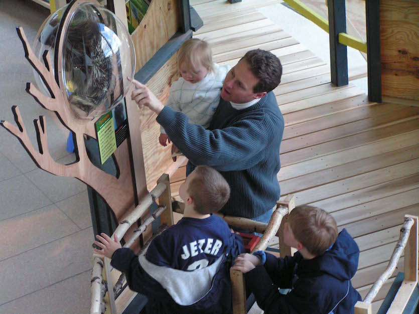 Photo of family viewing Tree Exhibit.