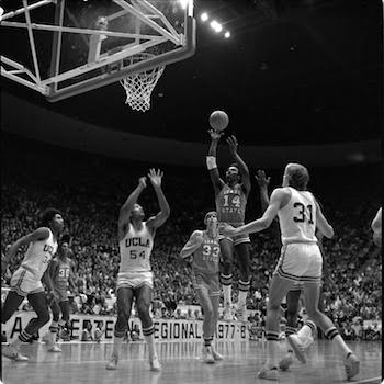 ISU player Ed Thompson taking a shot over UCLA defenders.