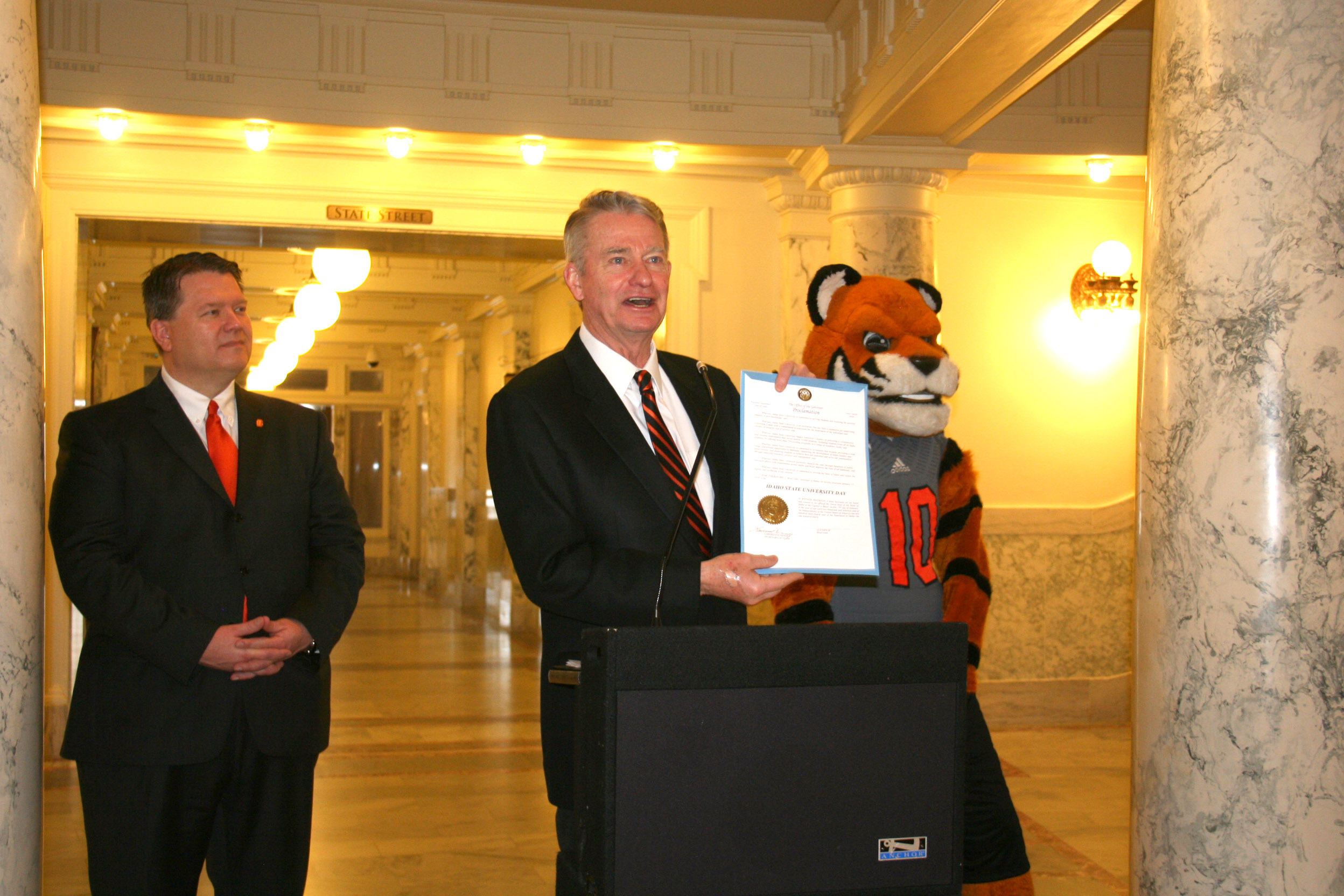 ISU President Kevin Satterlee, Idaho Gov. Brad Little and Benny the Bengal with the proclamation