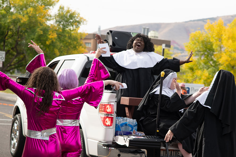 Theater student performing Sister Act on a float