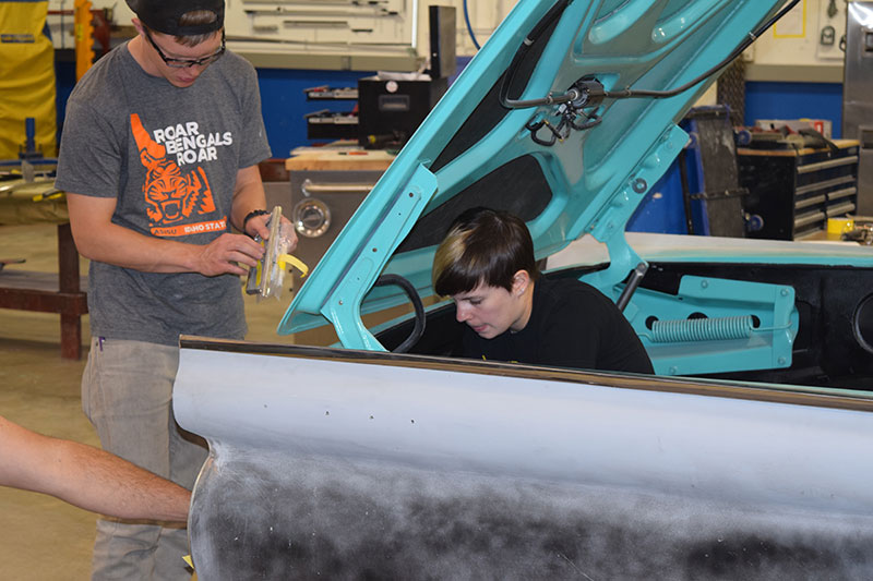 Students working on cars