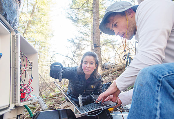Sarah Godsey and student conducting river quality research